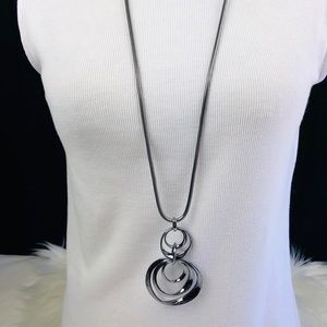 Long silver necklace with circles